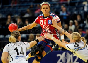 BELGRADE, SERBIA - DECEMBER 08: Svetlana Ognjenovic (C) of Serbia is challenged by Jana Knedlikova (R) and Petra Vitkova (L) of Czech Republic during the Women's European Handball Championship 2012 Group A match between Serbia and Czech Republic at Arena Hall on December 08, 2012 in Belgrade, Serbia. (Photo by Srdjan Stevanovic/Getty Images)